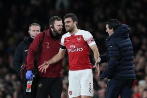 Arsenal had Sokratis Papastathopoulos sent off as they lost the first leg of their Europa League round of 16 tie against Rennes 3-1.