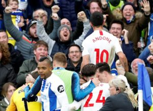 Brighton eased their relegation fears with a hard-fought 1-0 victory against rock-bottom Huddersfield Town.
