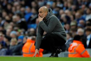 Pep Guardiola says he is not thinking about Manchester City completing an unprecedented quadruple this season.