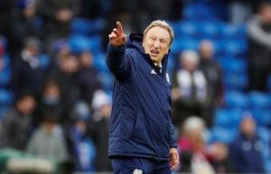 Neil Warnock says Cardiff are continuing to defy the odds and they are still in with a chance of survival in the Premier League.