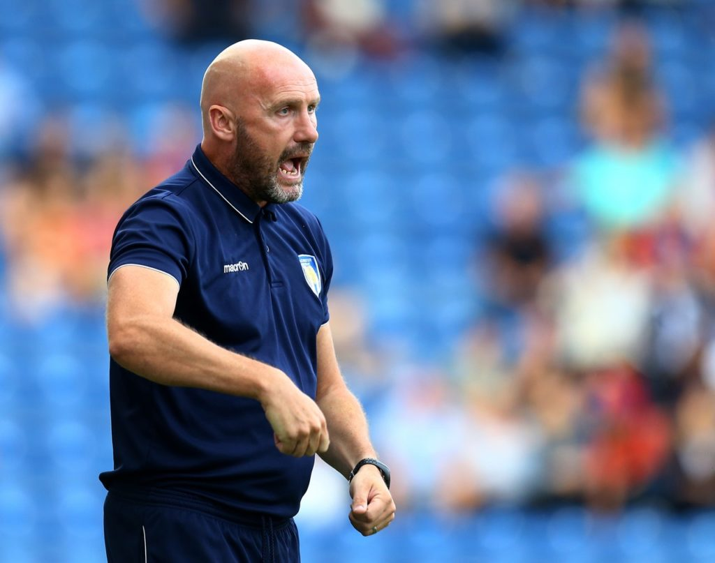Colchester boss John McGreal will be without suspended goalkeeper Dillon Barnes for the visit of promotion-chasing MK Dons.