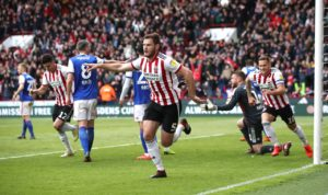 Goals from Scott Hogan and Jack O'Connell gave Sheffield United a 2-0 victory over Ipswich which leaves them on the brink of promotion to the Premier League.