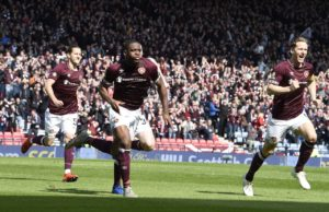 Hearts striker Uche Ikpeazu scored a late equaliser at Easter Road to deny Hibernian a second Edinburgh derby win this month.