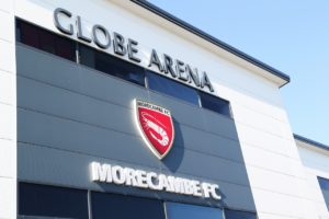 Morecambe and Grimsby shared the spoils in a drab 1-1 draw in League Two.
