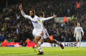 Leeds United striker Kemar Roofe says he is enjoying the promotion race as he tries to fire the club back into the Premier League.
