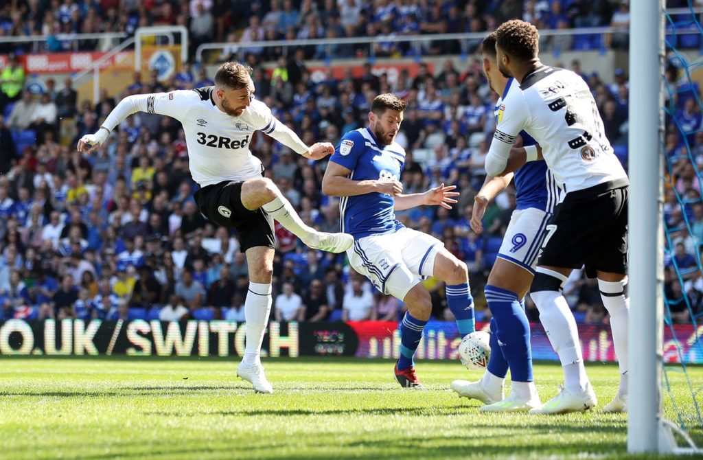 Derby's Championship play-off hopes suffered a setback as they had to settle for a 2-2 draw at Birmingham.