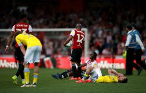Brentford dealt Leeds' hopes of an automatic return to the Premier League a hammer blow with a thrilling 2-0 win at Griffin Park.