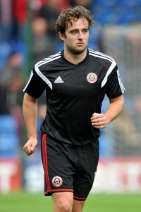Oldham will check on Jose Baxter ahead of Easter Monday's League Two clash with Mansfield.