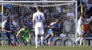 Gavin Massey bagged a brace as 10-man Wigan dented Leeds' automatic promotion dreams with a shock 2-1 win at Elland Road.