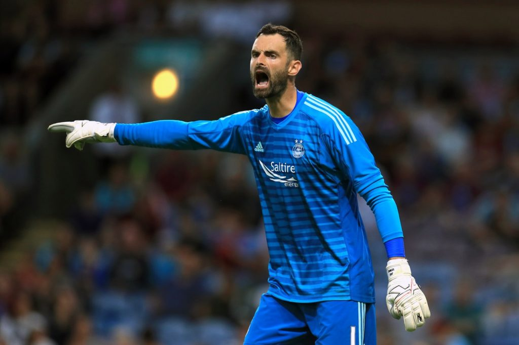 Aberdeen goalkeeper Joe Lewis admits he is baffled by the sectarian issue in Scottish football.