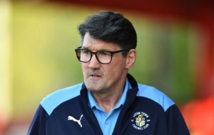 Mick Harford admitted his table-topping Luton side felt under pressure before their trip to Accrington - but a 3-0 win helped to ease their nerves.