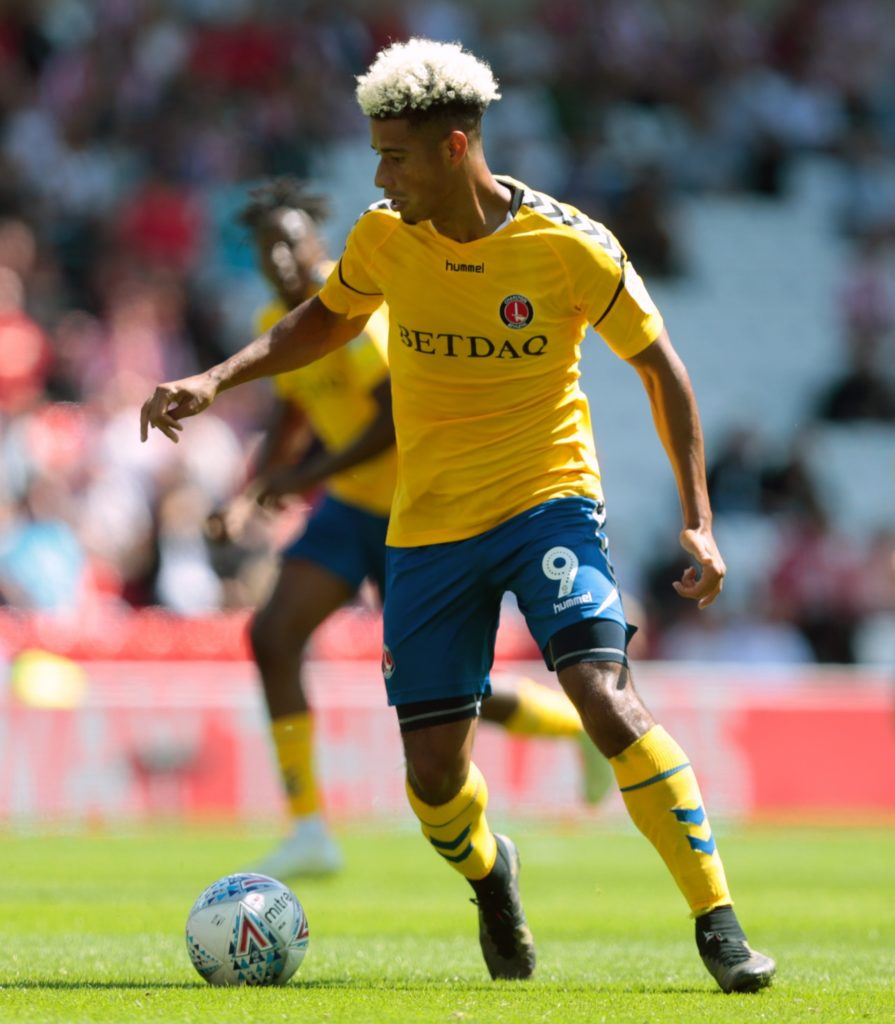 Lyle Taylor struck twice as Charlton came from a goal down to beat Luton 3-1 and end the League One leaders' long unbeaten run.