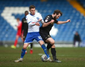 Bury will be without midfielder Danny Mayor for Tuesday night's League Two clash with Cambridge at Gigg Lane.