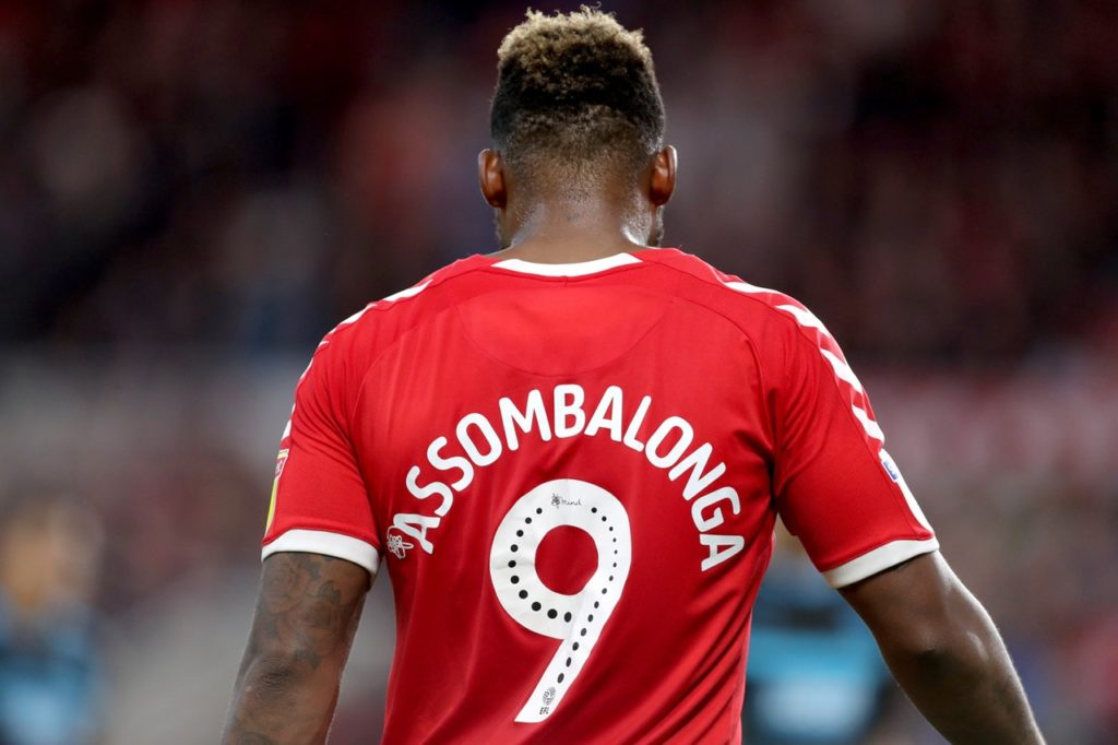 Britt Assombalonga's 13th goal of the season kept Middlesbrough's play-off hopes alive as they beat Hull 1-0.