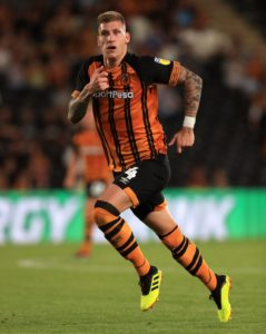 Jordy De Wijs headed a late winner to give Hull a 2-1 victory over relegation-threatened Wigan and keep them in Sky Bet Championship play-off contention.