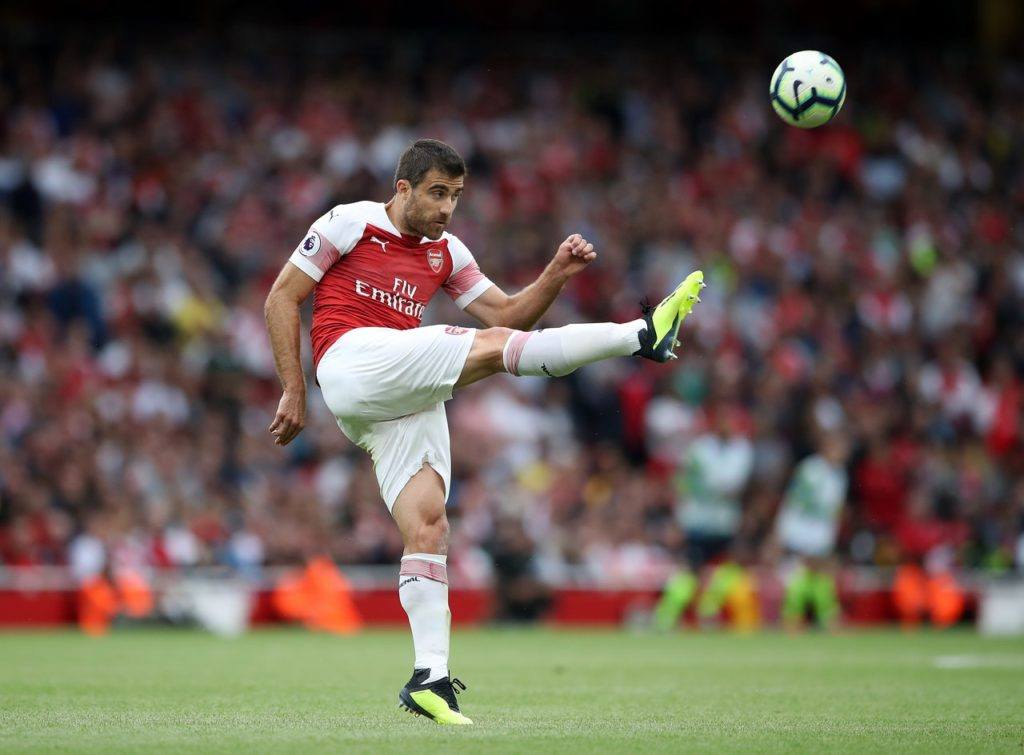 Arsenal will be without the suspended Sokratis Papastathopoulos when they travel to Watford looking to boost their top-four hopes.