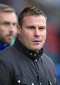 Mansfield's promotion charge suffered a setback as they were held to a 1-1 draw by Northampton on Saturday.