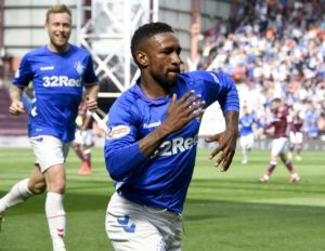 Celtic's Ladbrokes Premiership title party was put on hold for another week after Rangers claimed a 3-1 win over Hearts at Tynecastle.