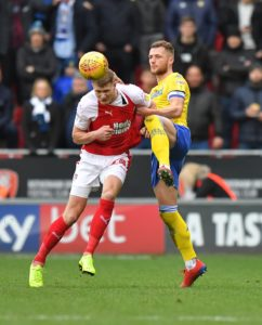 Rotherham manager Paul Warne hailed striker Michael Smith for helping his team record a vital 2-1 Championship win over Nottingham Forest.