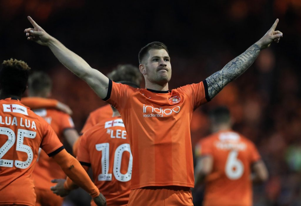 AFC Wimbledon gave their survival hopes a huge boost as Steve Seddon scored a stoppage-time equaliser to hold leaders Luton to a 2-2 draw at Kenilworth Road.
