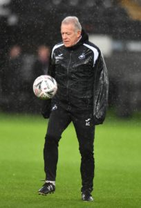 Swansea assistant coach Alan Curtis will retire at the end of the season ahead of being named honorary club president.