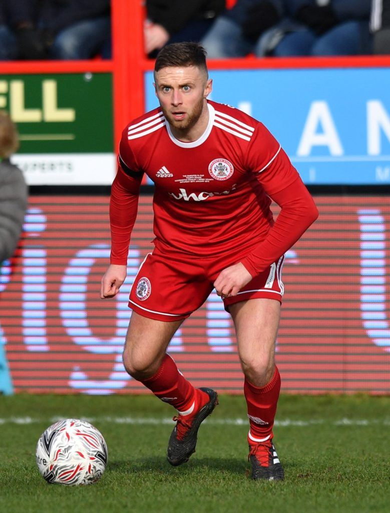 Accrington ended a run of three defeats as Jordan Clark's ninth goal of the season earned them a 1-1 draw against fellow strugglers AFC Wimbledon.