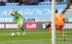 Norwich extended their lead at the top of the Sky Bet Championship after grinding out a 1-1 draw at relegation-threatened Wigan.