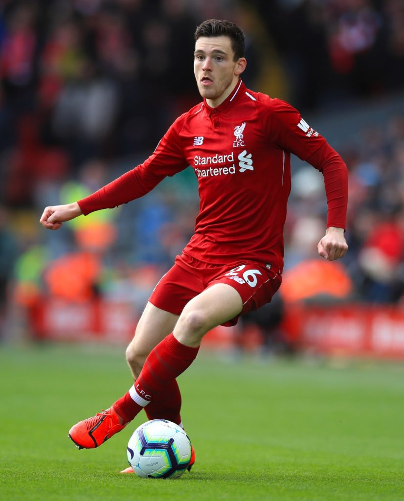 Liverpool left-back Andy Robertson is expected to come back into the side for the crucial Premier League visit of Chelsea.