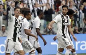 Juventus came from behind to beat Fiorentina 2-1 and secure the Serie A title for an eighth successive season.