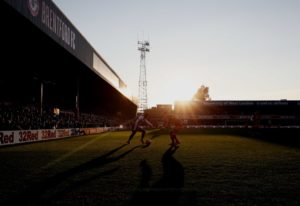 Josh Dasilva rocketed home his first senior goal as 10-man Brentford drew 1-1 at Millwall to keep their hosts scrapping for their Championship lives.