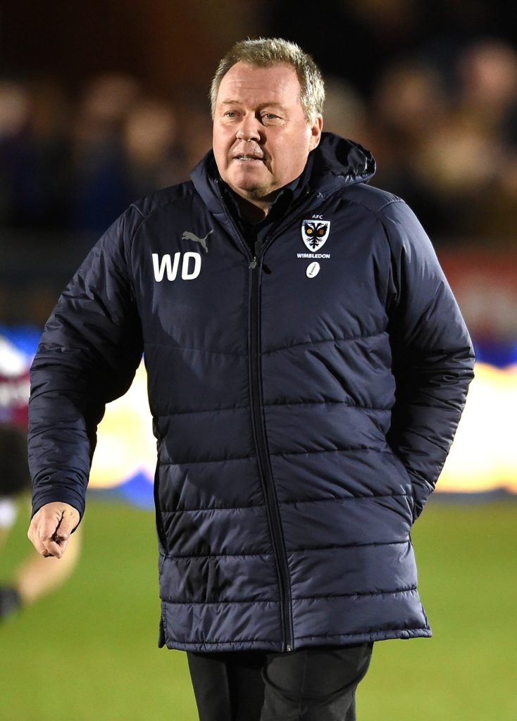 AFC Wimbledon boss Wally Downes was bursting with pride after his side boosted their survival hopes with a stoppage-time equaliser to draw 2-2 at leaders Luton.