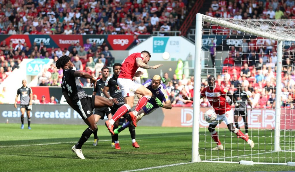 Josh Brownhill headed a 72nd minute equaliser to earn play-off contenders Bristol City a precious point in a 1-1 Championship draw with Reading at Ashton Gate.