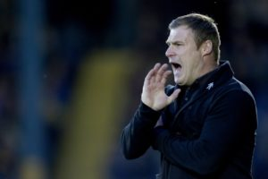 Mansfield boss David Flitcroft was furious with the match officials after his promotion-chasing side fell to a controversial 3-2 defeat at Oldham.