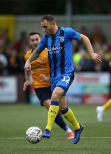 Gillingham defender Barry Fuller has signed a new one-year deal, the Sky Bet League One club have announced.