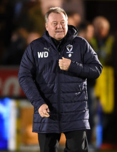 There were mixed feelings for Wally Downes after watching his AFC Wimbledon side held to a 1-1 draw at home to fellow strugglers Accrington.