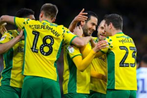 Norwich won promotion to the Premier League after turning in a scintillating display to beat Blackburn 2-1 at Carrow Road.
