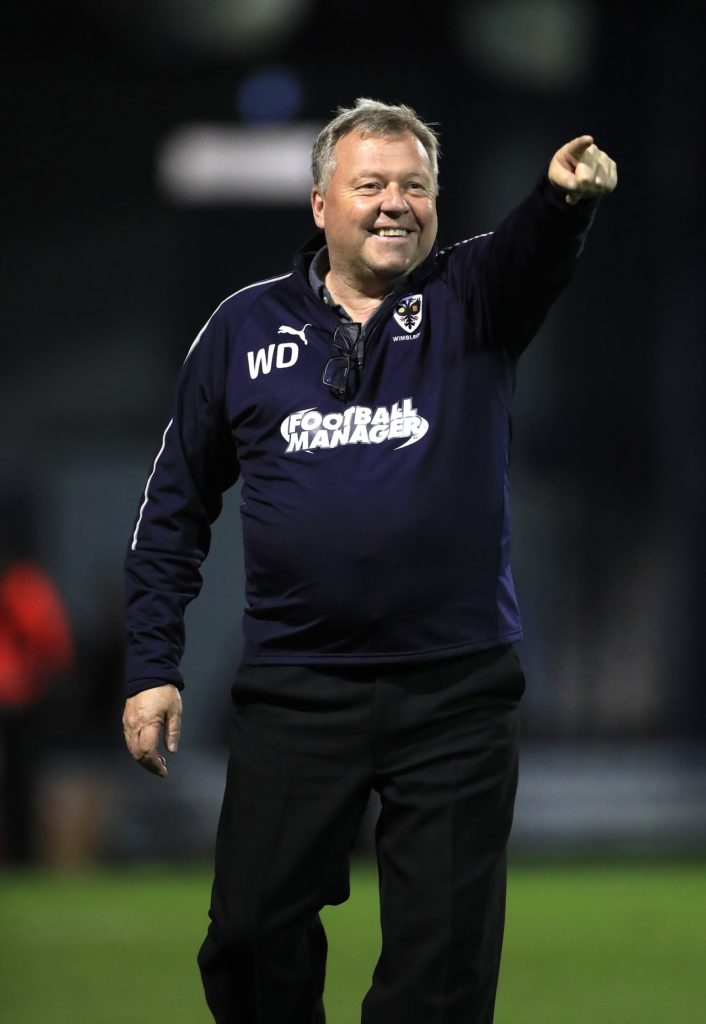 AFC Wimbledon manager Wally Downes is targeting one more victory to secure his side's safety after they overcame Wycombe 2-1.