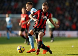 Eddie Howe has hailed Steve Cook as an 'unbelievable character' whose return to fitness is timely for Bournemouth's run-in.