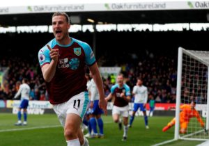 Burnley striker Chris Wood says he is delighted to have reached double figures in goals in the Premier League this season.