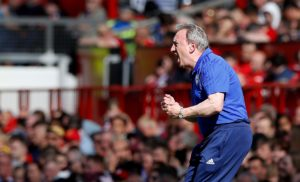 Lee Peltier hopes Neil Warnock will stay on as manager after relegated Cardiff went out with a bang by beating Manchester United.
