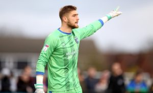Ipswich have signed Gillingham goalkeeper Tomas Holy on a two-year deal with the option of an extra 12 months.
