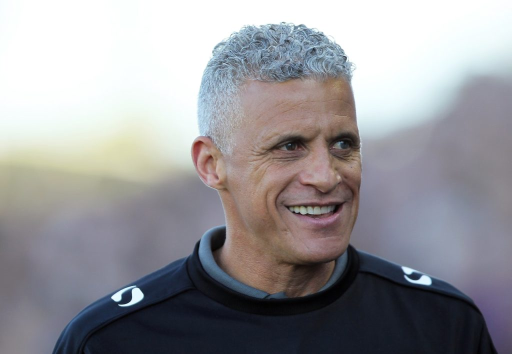 Northampton manager Keith Curle has made his fourth signing in just 10 days by bringing in striker Harry Smith from Macclesfield.