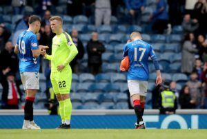 Rangers survived the closing stages of a 1-0 win over Hibernian with midfielder Ross McCrorie in goal after Allan McGregor was sent off.