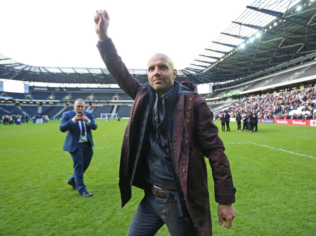 Paul Tisdale believes MK Dons' promotion back to League One was payback for the supporters who have stuck with the club through their dark days.