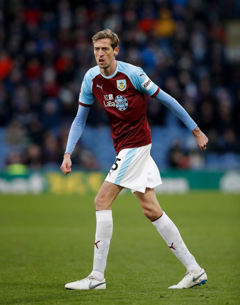 Burnley striker Peter Crouch thinks the club will finish in the top half of the table next season whether he's there or not.