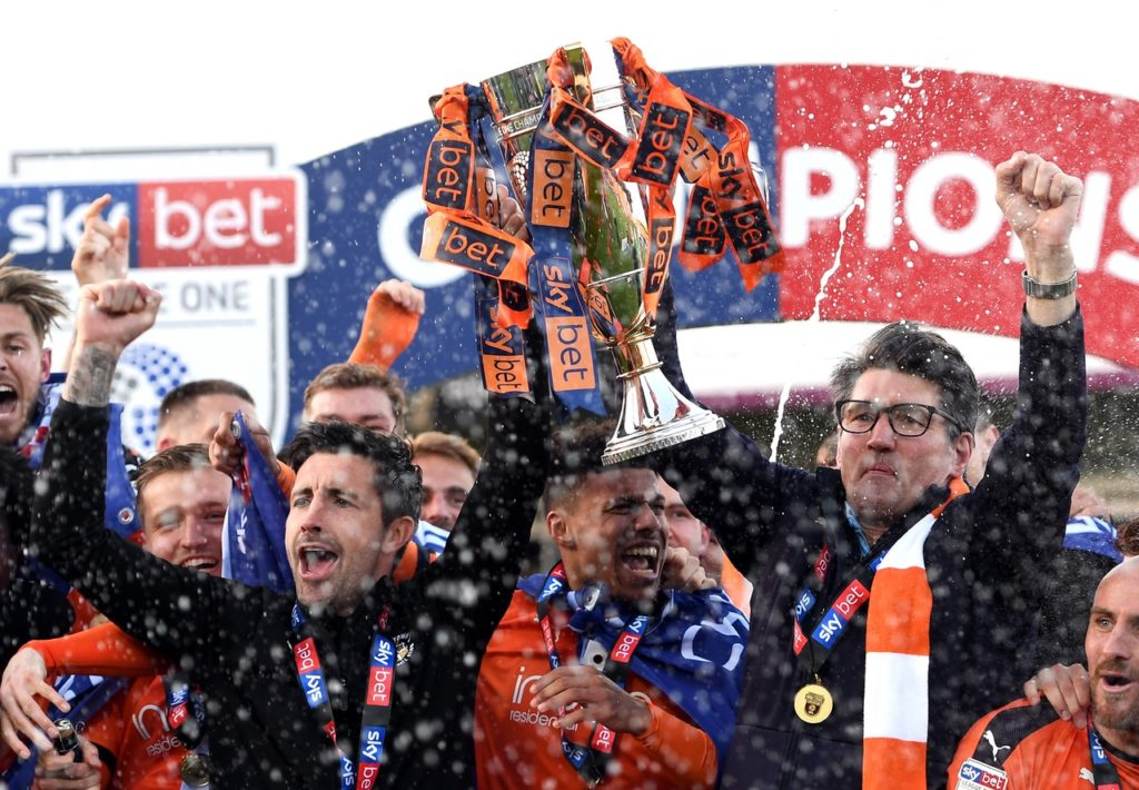 Mick Harford labelled Luton's League One heroics as a 'brilliant achievement' after they were crowned champions following a 3-1 win against Oxford.