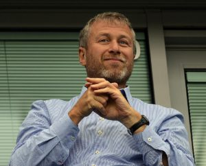 Chelsea defender David Luiz says owner Roman Abramovich still 'loves the club' despite his absence from Stamford Bridge.