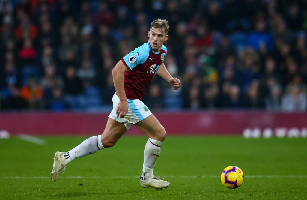 Burnley defender Charlie Taylor says he can see no reason why his side cannot finish in the top half of the Premier League next season.
