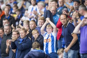 Kilmarnock manager Steve Clarke has urged fans to vindicate the club's decision to cut Rangers' ticket allocation and back their team to glory.