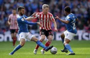 Portsmouth will face Sunderland in the League One play-off semi-final after being held at home to a 1-1 draw by Accrington.